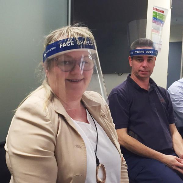 Kathy Dempsey wearing a face shield during a review session