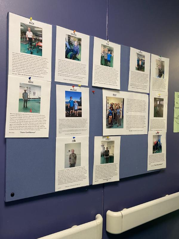 A series of success story posters on a blue wall